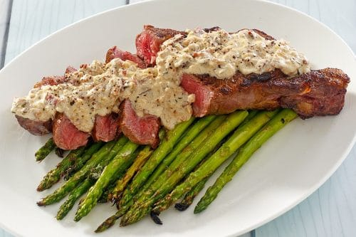 Ribeye & Asparagus topped with Bacon Bourbon Cream Sauce from the Beefer