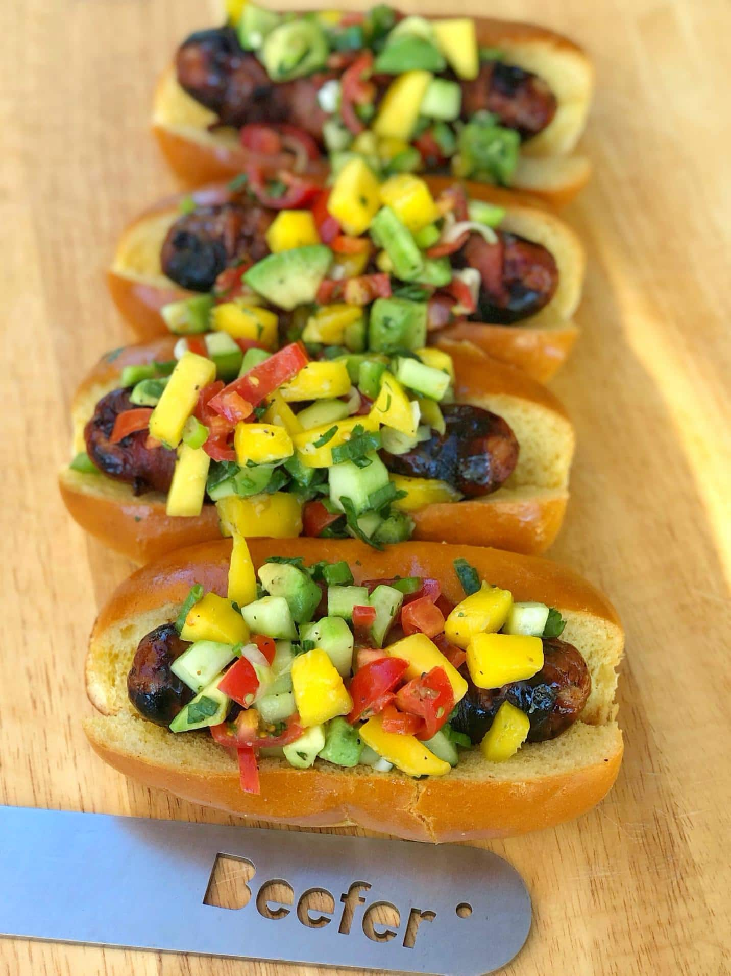 Bacon Wrapped Sausages with Mango, Avocado and Cucumber Salsa